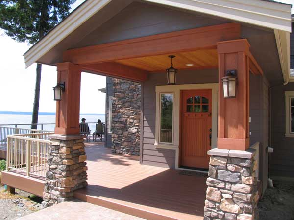 Entry to newly built custom craftsman home with stone and fine woodworking.