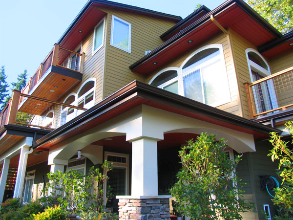 Lake Sammamish three story home with bold exterior paint color palette by ColorWhiz, Krause House Painting, and Miller Paints.