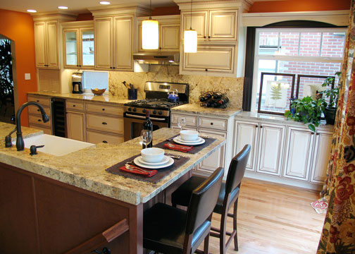 Classic creamy kitchen cabinets with orange walls and espresso window trim